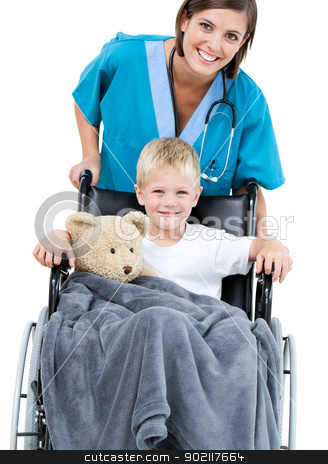Beautiful female doctor carrying adorable little boy in the whee stock photo, Beautiful female doctor carrying adorable little boy in the wheelchair at the hospital by Wavebreak Media
