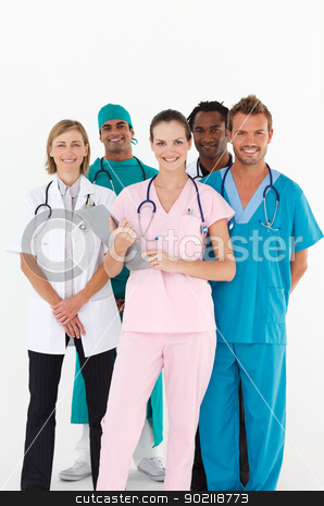 Friendly group of doctors smiling at the camera stock photo, Friendly group of multi-ethnic doctors smiling at the camera by Wavebreak Media