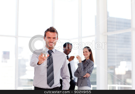 Business people drinking champgne in the office with copy-space stock photo, Young business people drinking champgne in the office with copy-space by Wavebreak Media