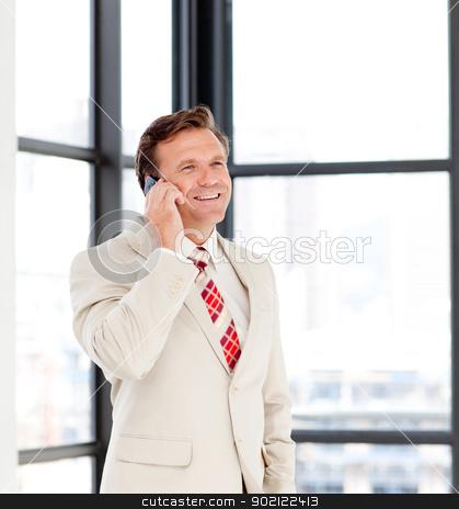 Happy mature businessman on phone stock photo, Happy mature businessman talking on phone by Wavebreak Media