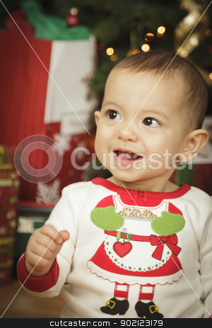 Infant Baby Enjoying Christmas Morning Near The Tree stock photo, Cute Infant Baby Enjoying Christmas Morning Near The Tree. by Andy Dean