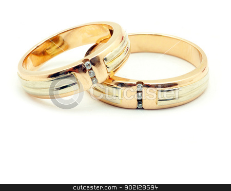 rings  stock photo, Gold wedding rings isolated on white background by Vitaliy Pakhnyushchyy