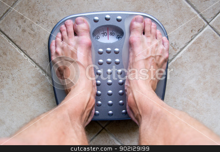 Feet on a scale stock photo, Feet on a weighing scale by Vitaliy Pakhnyushchyy