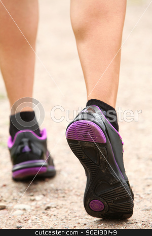 Close up of walking legs on the road stock photo, Close up of walking legs in shoes on the road by yekostock