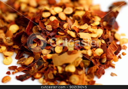 Chili Pepper Flakes stock photo, Closeup of chili pepper flakes on white background. by Henrik Lehnerer