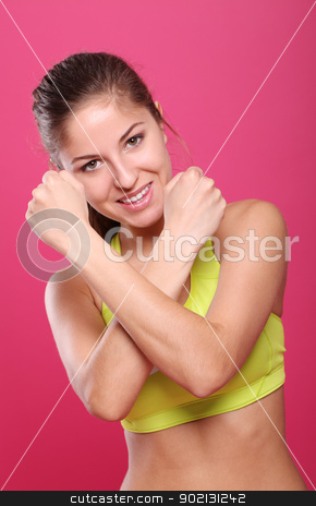 Beautiful slim sporty girl portrait over a pink stock photo, Beautiful slim sporty girl portrait over a pink background by yekostock