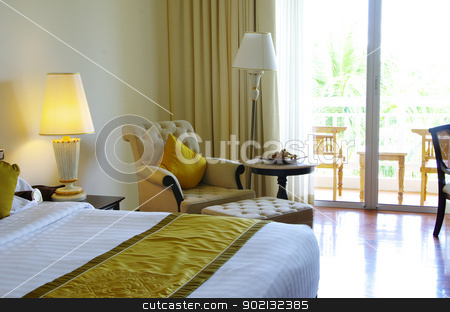 hotel room stock photo, Luxurious hotel room interior with bed by Vitaliy Pakhnyushchyy