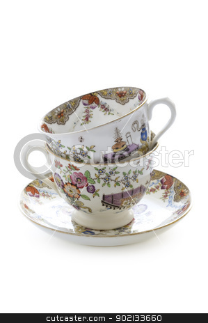 vintage tea cups stock photo, two vintage china tea cups stacked isolated on white by Lee Avison