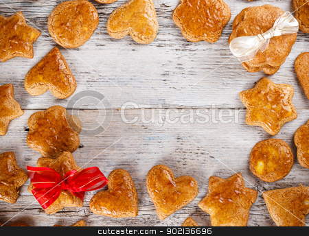 Gingerbread cookies stock photo, Christmas homemade gingerbread cookies over wooden table  by Grafvision