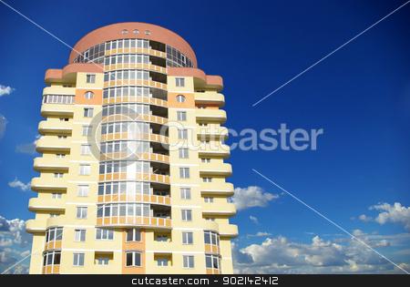 modern apartments stock photo, A modern apartments building on sky by Vitaliy Pakhnyushchyy