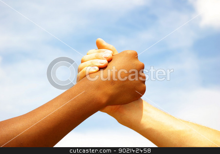 hands stock photo, Two young businessmen shaking hands by Vitaliy Pakhnyushchyy