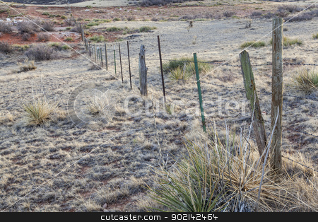 cattle barbed wire fence stock photo, cattle barbed wire fence in semi desert ranch in northern Colorado near Wyoming border by Marek Uliasz