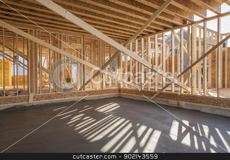 New house construction stock photo, New house construction with newly poured garage floor by Christian Delbert