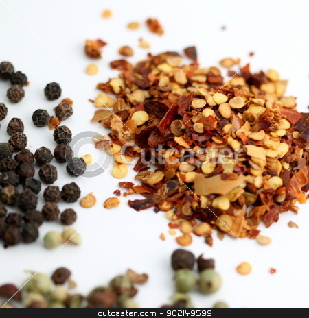Chili Pepper stock photo, Closeup of chili flakes, black and green pepper. by Henrik Lehnerer