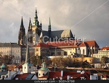 Prague Castle stock photo, Prague Castle and panorama roofs of old Prague in the afternoon sun by Ondrej Vladyka