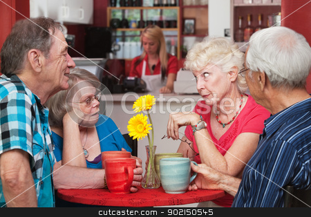 Mature Group of Friends Talking stock photo, Concerned woman conversing with friends in bistro by Scott Griessel