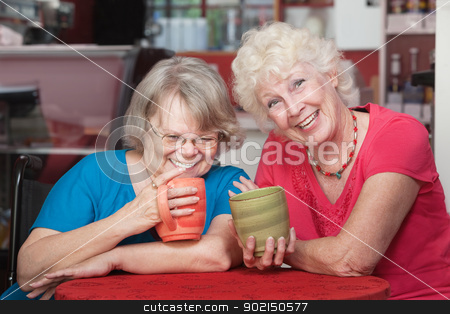 Pair of Happy Friends stock photo, Two smiling senior friends holding coffee mugs by Scott Griessel