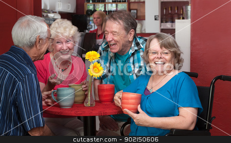 Laughing Lady in Wheelchair stock photo, Laughing senior woman in wheelchair with friends in bistro by Scott Griessel