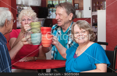 Senior Group Toasting Drinks stock photo, Happy group of older people toasting in a restaurant by Scott Griessel