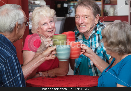 Senior Adults Toasting with Mugs stock photo, Joyful group of senior adults toasting with coffee mugs by Scott Griessel