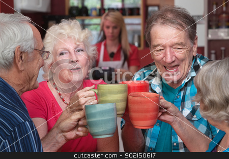 Group of Four Seniors Celebrating stock photo, Group of four happy seniors with mugs toasting by Scott Griessel