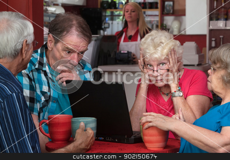 Lady and Friends With Laptop Problem stock photo, Upset elderly woman with laptop and friends helping by Scott Griessel