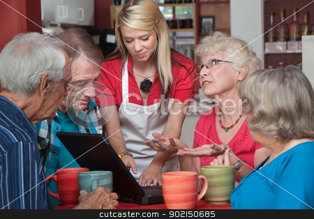 Woman Helping Seniors with Computer stock photo, Young waitress in cafe helping senior citizens with laptop by Scott Griessel
