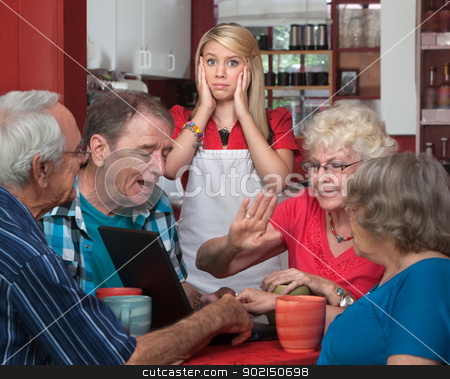 Young Waitress and Arguing Seniors stock photo, Stressed out waitress and bickering senior adults in a cafe  by Scott Griessel