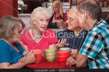 Pretty Senior Woman Talking with Friends stock photo, Pretty senior woman talking with friends in coffeehouse by Scott Griessel