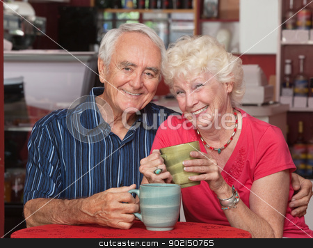 Happy Caucasian Elderly Couple stock photo, Attractive elderly Caucasian couple sitting together in cafe by Scott Griessel