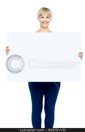 Post your ad here stock photo, Charming woman displaying blank whiteboard to the camera. by Ishay Botbol
