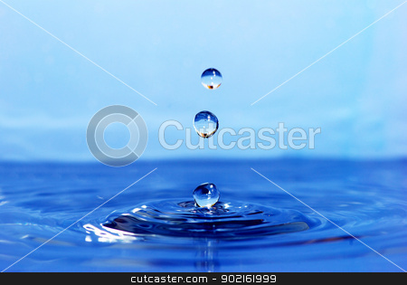 Water drop stock photo, The round transparent drop of water falls downward by Vitaliy Pakhnyushchyy