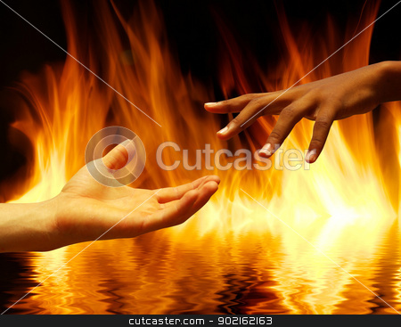 fire stock photo, helping hand with the fire  background       by Vitaliy Pakhnyushchyy