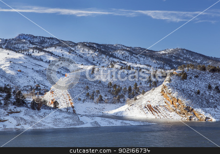 mountain lake in winter stock photo, Horsetooth Rock and Reservoir near Fort Collins, Colorado, winter scenery with strong wind by Marek Uliasz