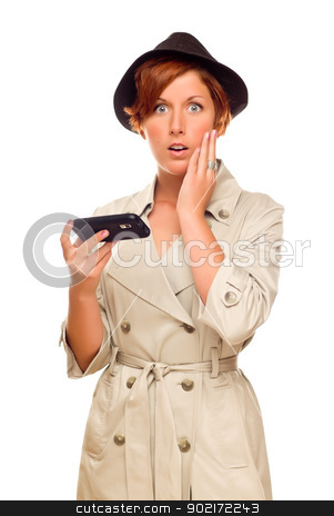 Shocked Young Woman Holding Smart Cell Phone on White stock photo, Shocked Young Woman Holding Smart Cell Phone Isolated on a White Background. by Andy Dean