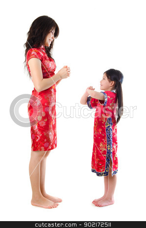 Chinese parent and child stock photo, Chinese parent and child in traditional Chinese cheongsam greeting, isolated on white background  by szefei