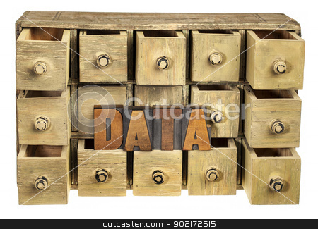 data storage concept stock photo, data storage concept - data word in vintage letterpress wood type and primitive rustic wooden apothecary or catalog drawer cabinet by Marek Uliasz
