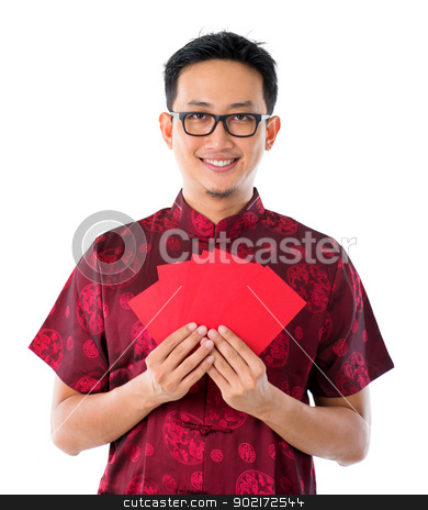 Red packet stock photo, Southeast Asian male in cheongsam hands holding red packets / ang pow, isolated on white background. by szefei