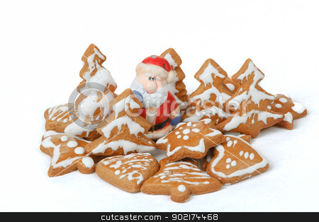 christmas gingerbreads and ceramic santa on white background stock photo, homemade christmas gingerbreads and ceramic santa on white background by Artush