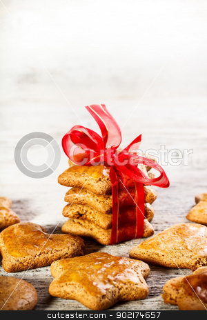 Christmas gingerbread cookies stock photo, Christmas gingerbread cookies tied with red ribbon by Grafvision