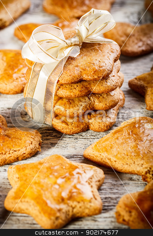 Christmas gingerbread cookies  stock photo, Christmas gingerbread cookies tied with white ribbon by Grafvision