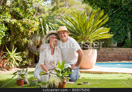 Senior couple looking at the camera in the garden stock photo, Senior couple looking at the camera in the garden by Wavebreak Media