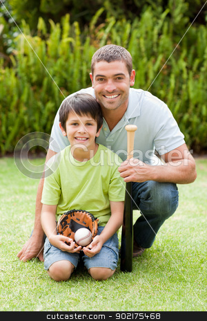 Happy father and his son playing baseball stock photo, Happy father and his son playing baseball by Wavebreak Media