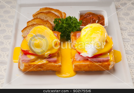 eggs benedict on bread with tomato and ham stock photo, fresh eggs benedict on bread with tomato and ham by Francesco Perre