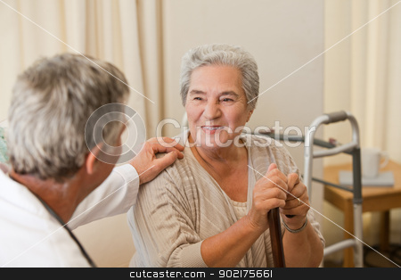 Senior doctor talking with his patient stock photo, Senior doctor talking with his patient by Wavebreak Media
