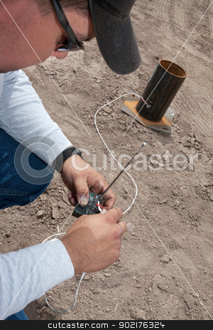 Pyrotechnic Expert Wiring a Remote Control stock photo, Pyrotechnic expert setting up remote control device by Scott Griessel
