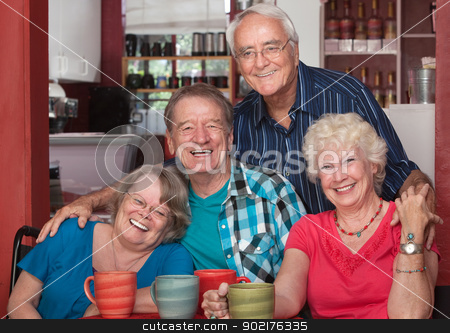 Laughing Seniors in Cafe stock photo, Four senior citizens laughing together in cafe by Scott Griessel