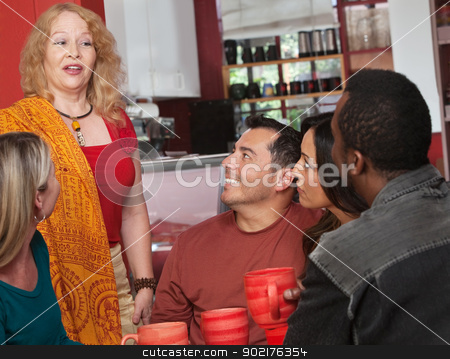 Woman Talking with Friends in Cafe stock photo, Mature Caucasian female talking with diverse group in cafe by Scott Griessel