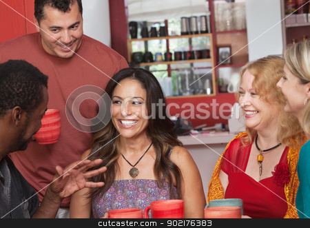 Hispanic Woman with Friends stock photo, Pretty Hispanic woman and diverse group of friends by Scott Griessel