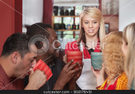 Attendant Bringing Coffee Mugs stock photo, Diverse group of customers with mugs and restaurant attendant by Scott Griessel